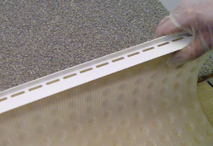 Ventilating the top edge of a wall Membrane